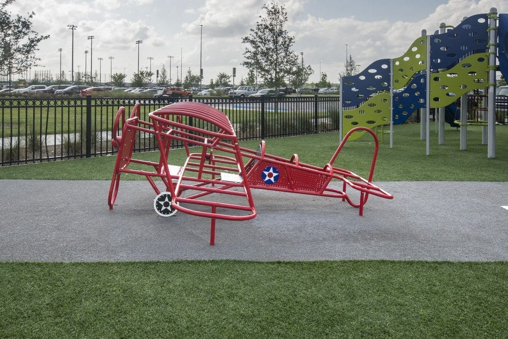 photo gallery featuring playground grass installations