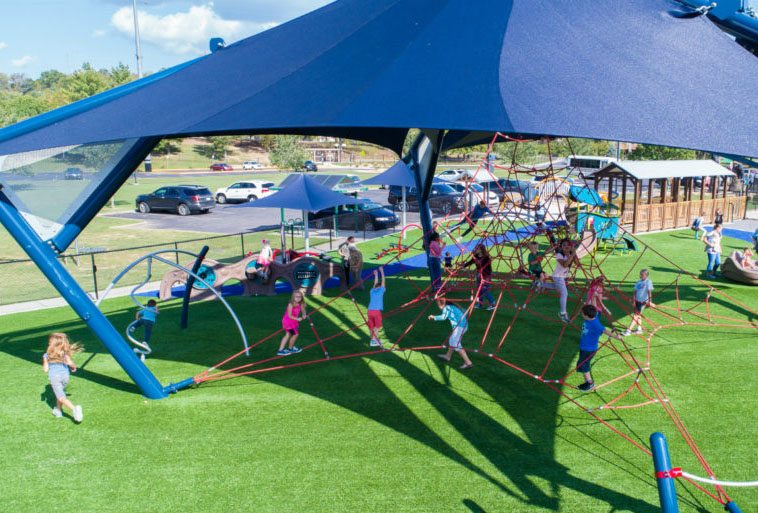 Mt. Ton of Fun featuring Playground Grass by ForeverLawn and LSI's Lunar Blast Shade Climber