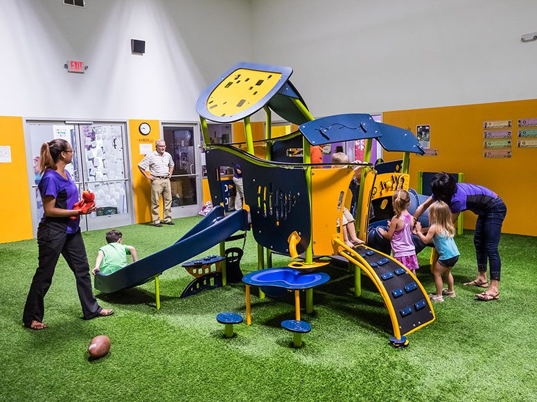 Smart Start Child Care indoor playground featuring Playground Grass by ForeverLawn