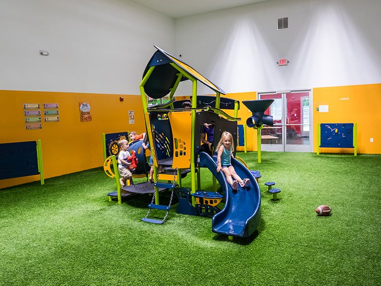 Smart Start Child Care playground featuring Playground Grass by ForeverLawn