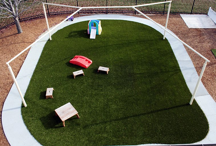 Playground Grass by ForeverLawn covering play mounds at Security Benefit Academy in Topeka, Kansas