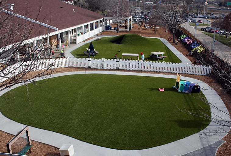 Security Benefit Academy in Topeka, Kansas featuring Playground Grass Ultra by ForeverLawn