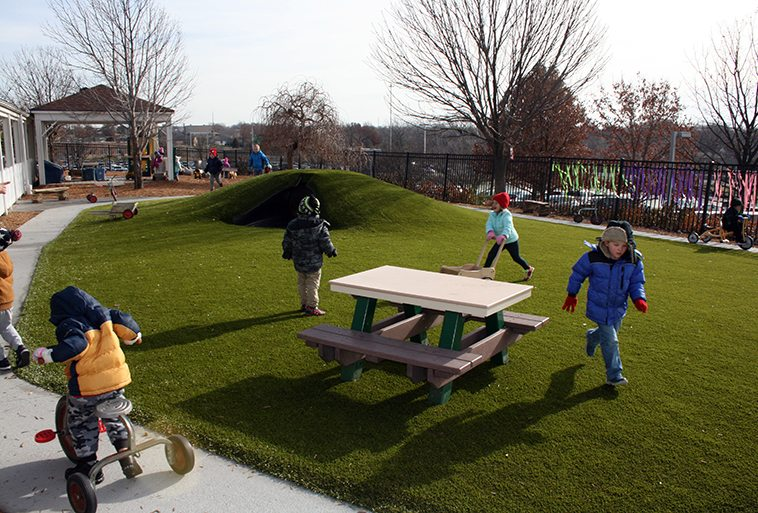 Kids playing on Playground Grass Ultra by ForeverLawn at Security Benefit Academy child care center