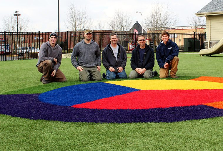 ForeverLawn of Puget Sound team on newly installed Playground Grass Extreme at Primrose School of Hillsboro