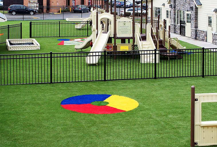 Primrose School of Hillsboro featuring Playground Grass Extreme with colorful design installed by ForeverLawn of Puget Sound