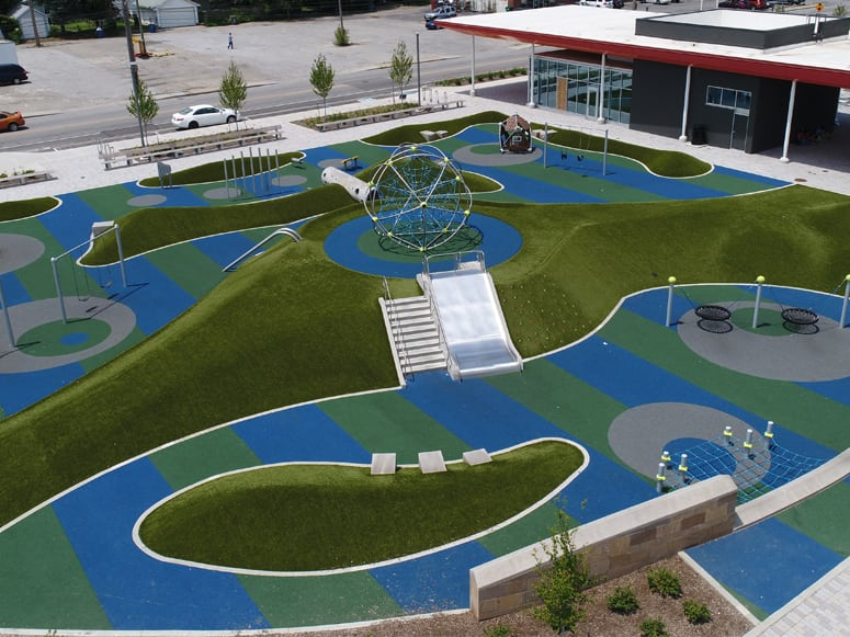 Tarkington Park in Indianapolis, IN, featuring Playground Grass® Ultra by ForeverLawn