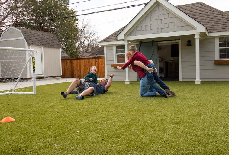 Copp Family from Fixer Upper playing on Playground Grass