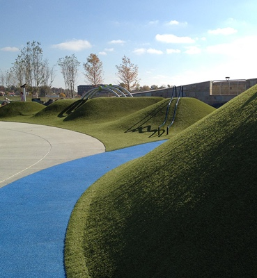 PlayMounds at Summit Park in Blue Ash, Ohio featuring Playground Grass synthetic turf by ForeverLawn