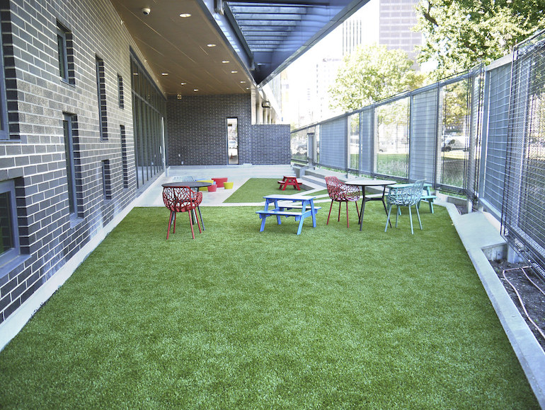 Playground Grass synthetic turf installed at Dayton Metro Library by ForeverLawn of Ohio